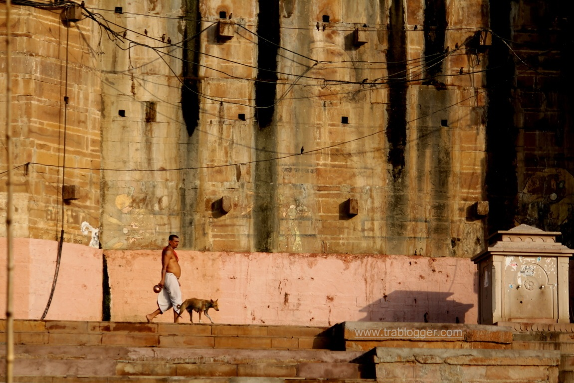a man walking through the ghats