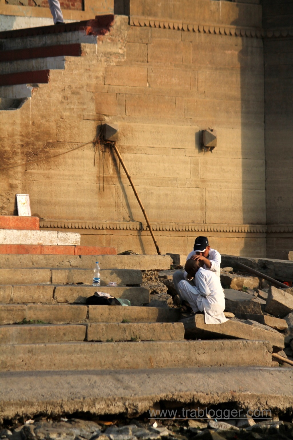 A man tonsuring at Varanasi ghats